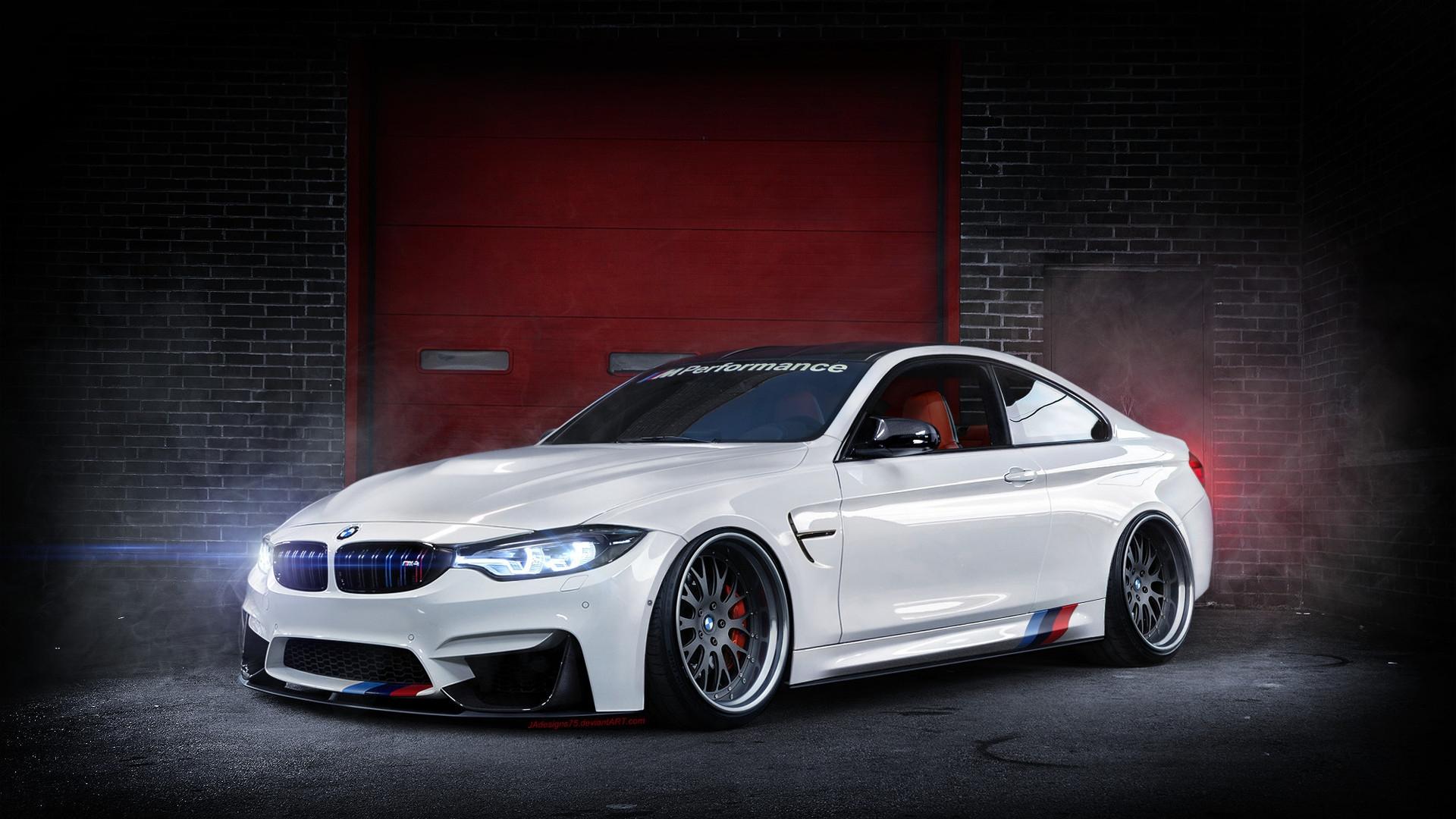 A beautiful white BMW F82 M4 in a garage Wallpaper ...