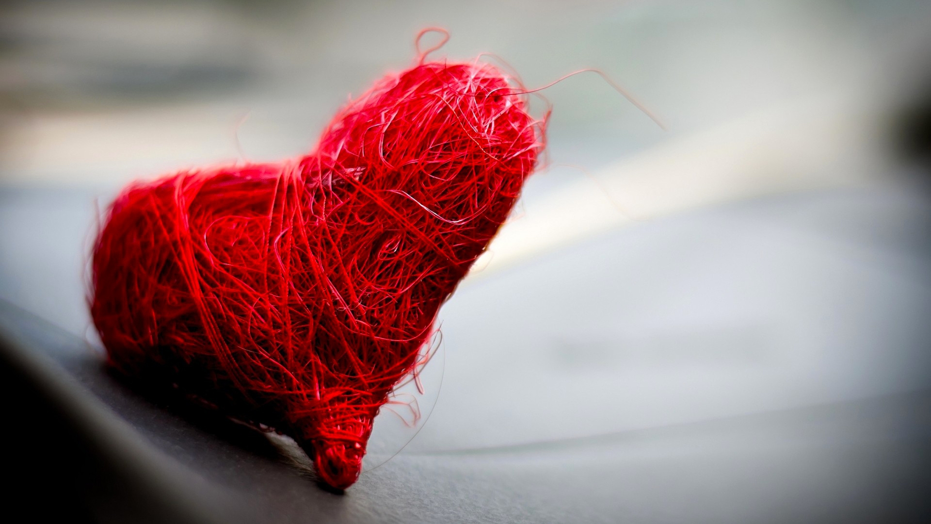 A heart made of red thread