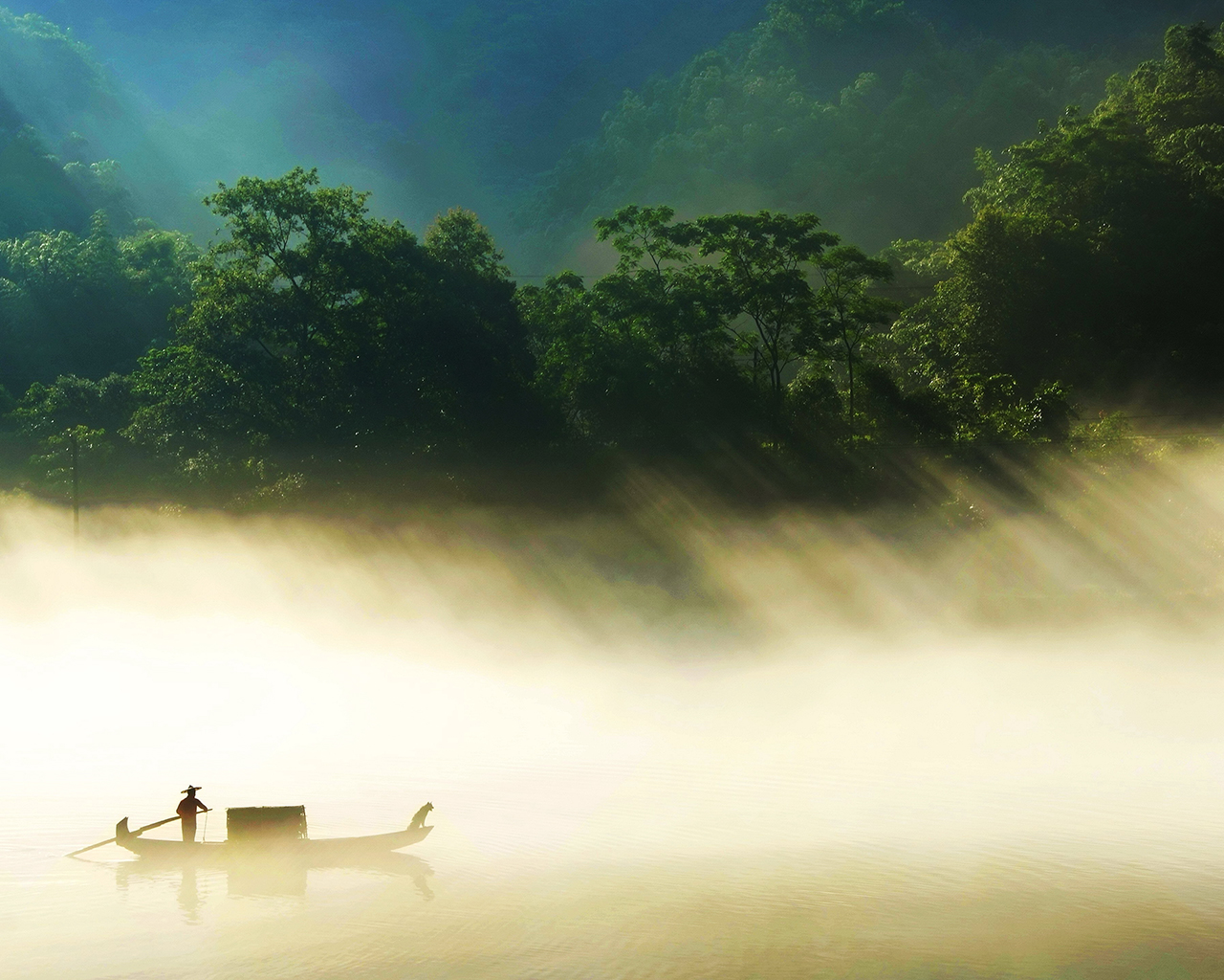 A man and his dog with boat on the river in the sunlight
