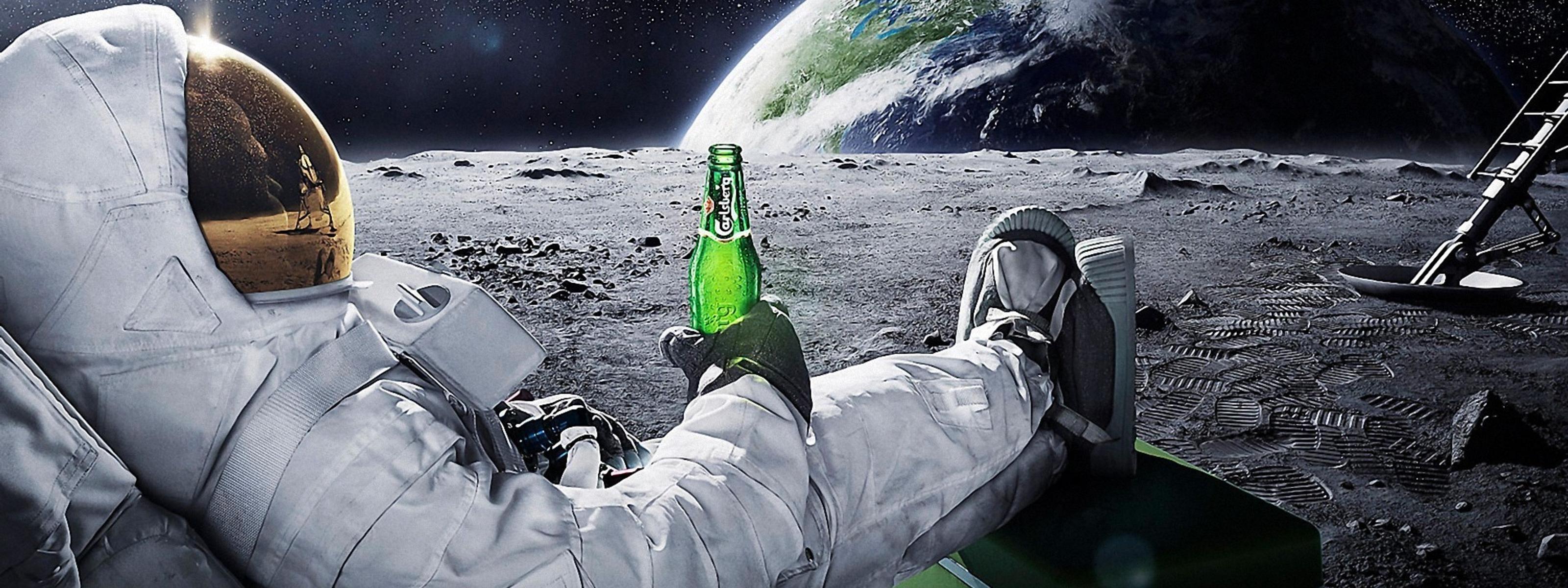 Download Wallpaper 3200x1200 A Men In Space With Carlsberg Beer