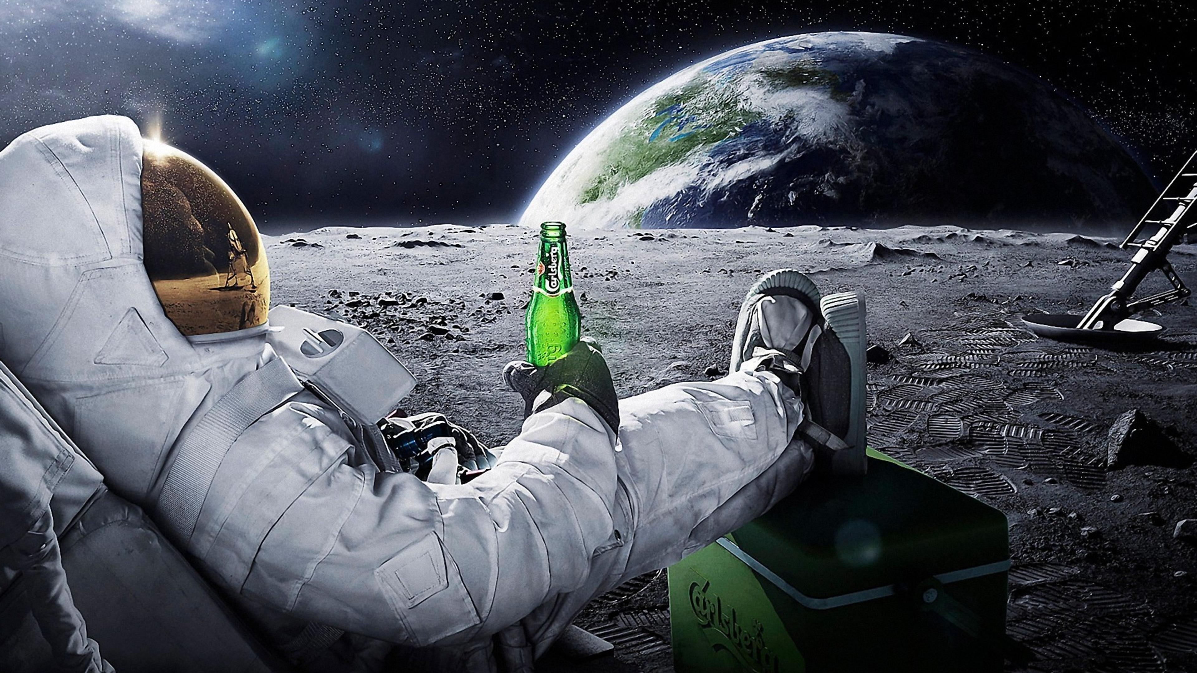 A Men In Space With A Carlsberg Beer Wallpaper Download