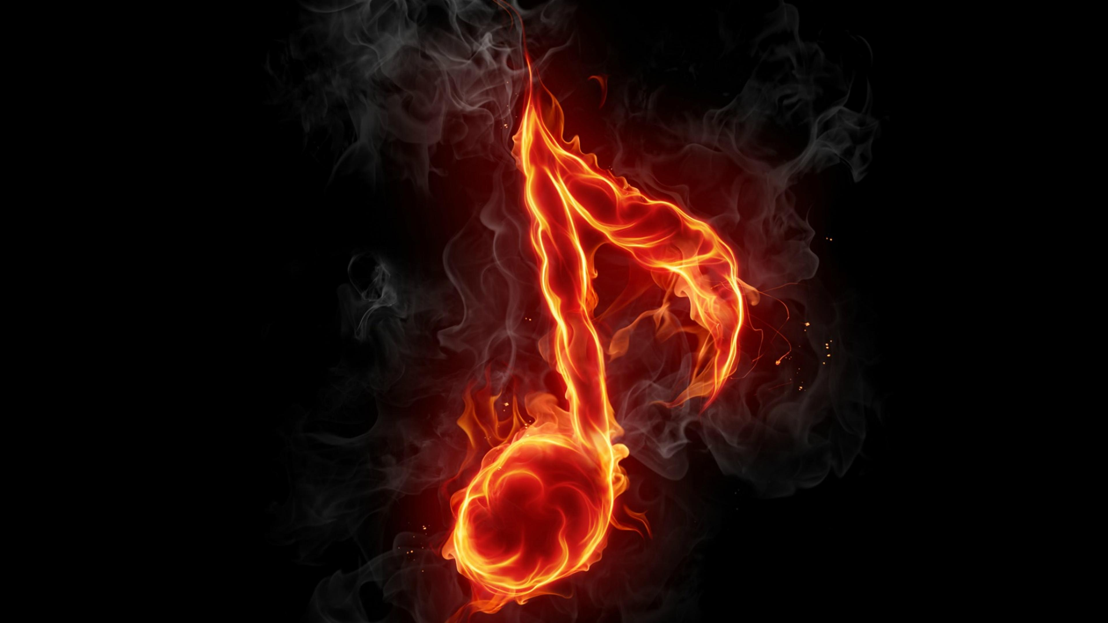 Download Wallpaper 3840x2160 A Musical Note In Flames On The Black Background