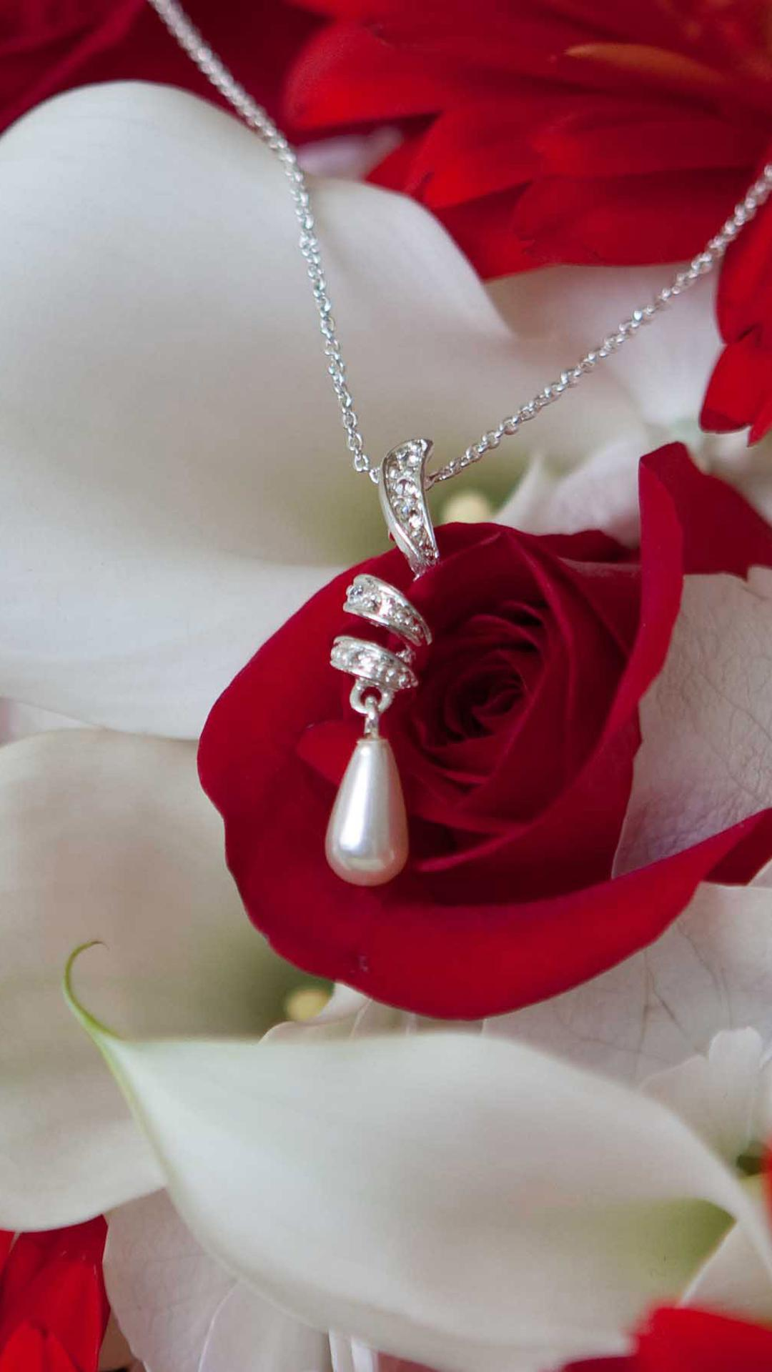 A necklace with a pearl on the white and red flowers wallpaper a necklace with a pearl on the white and red flowers wallpaper download 1080x1920 mightylinksfo