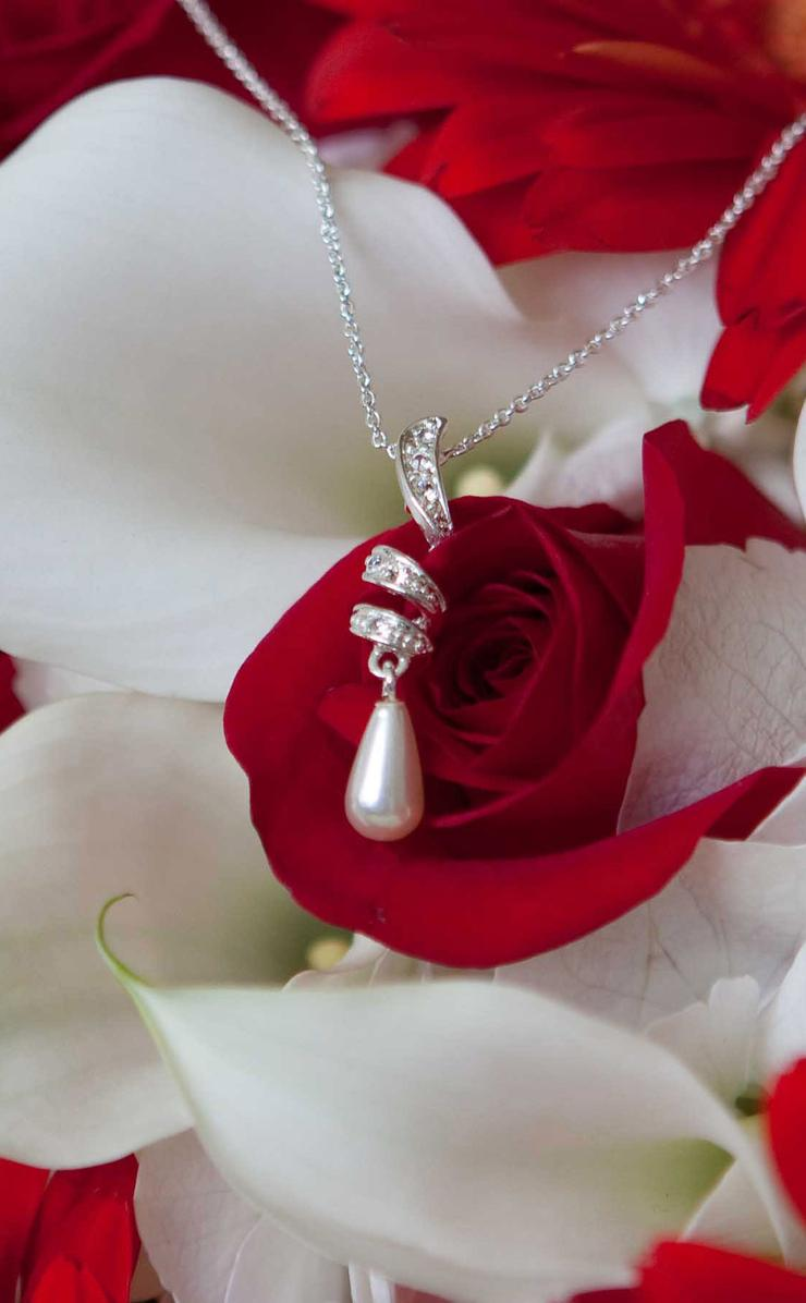 A necklace with a pearl on the white and red flowers wallpaper a necklace with a pearl on the white and red flowers wallpaper download 740x1196 mightylinksfo