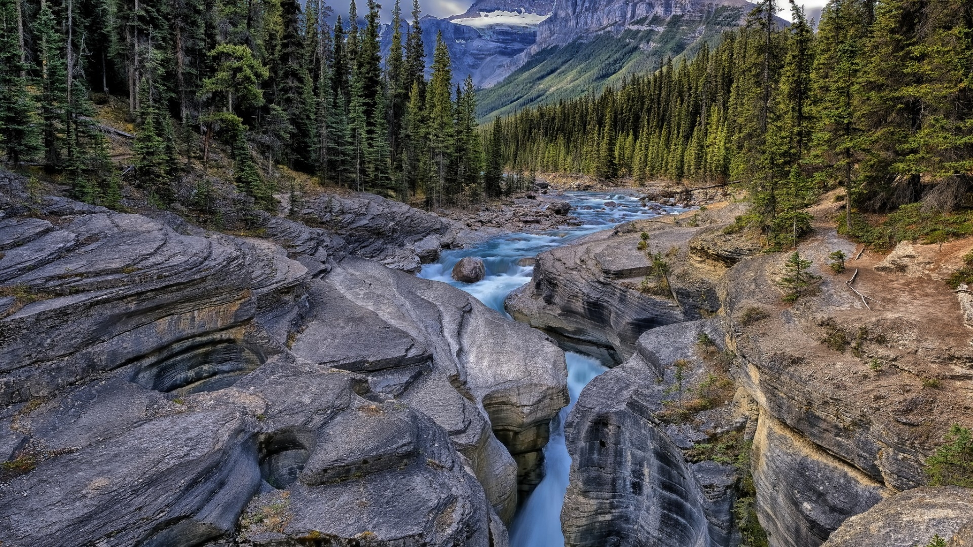 A river through the rocks in the mountains