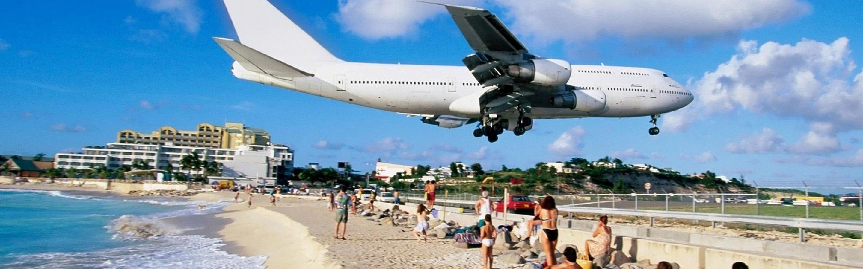 http://www.superiorwallpapers.com/download/airplane-above-the-beach-ready-to-land-2880x900.jpg