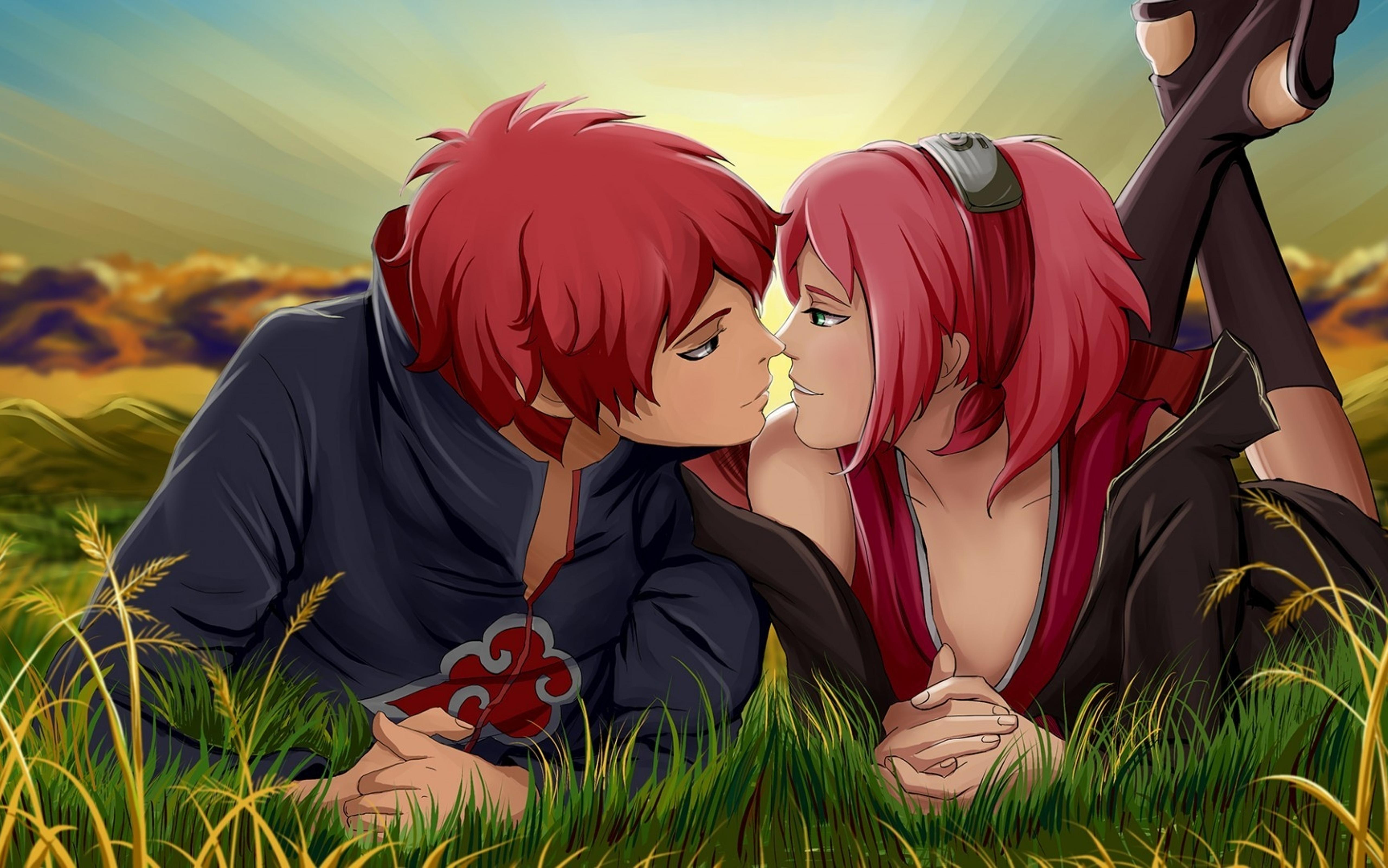 an anime couple with red hair kissing in the grass wallpaper