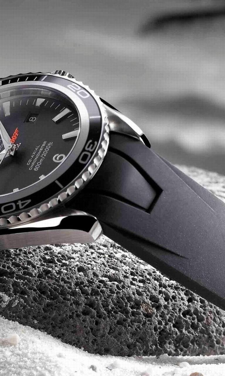 Black Omega Watch In Snow Hd Wallpaper Download 768x1280