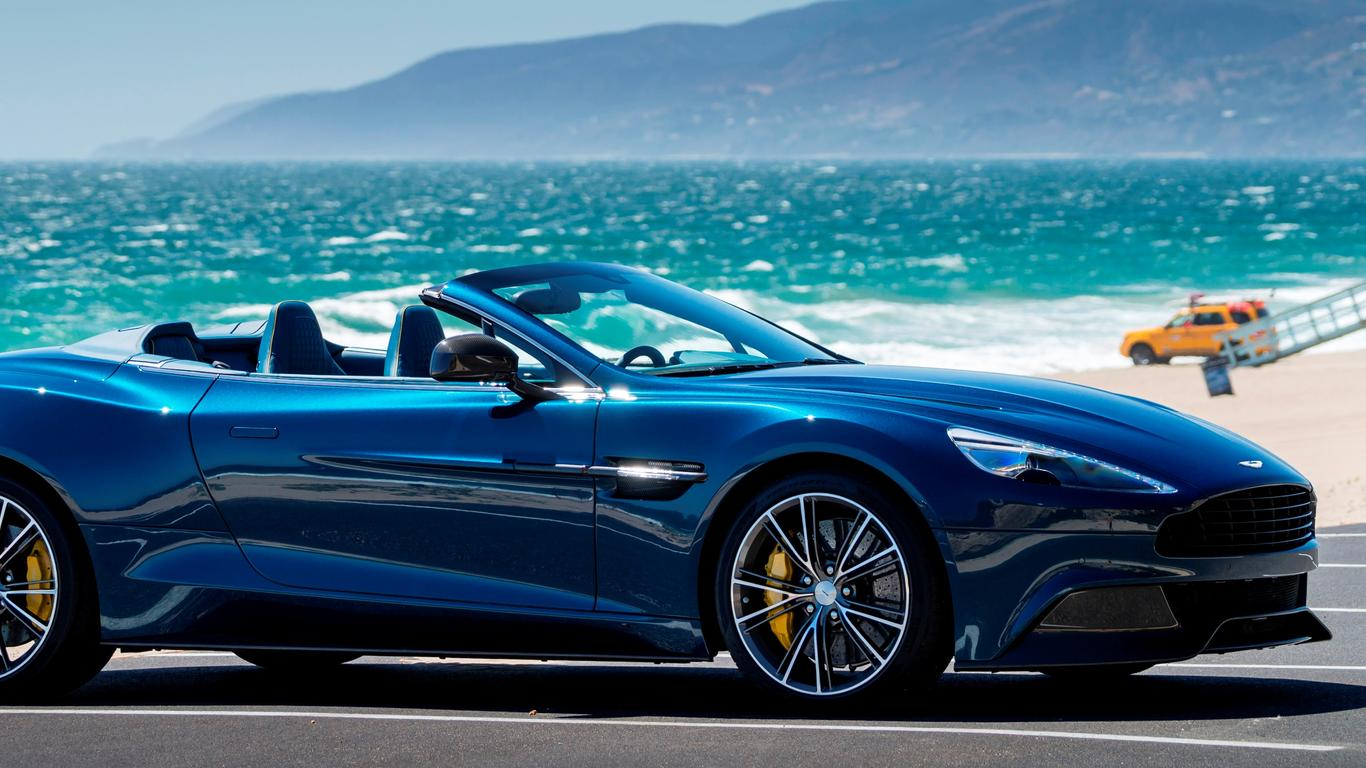 blue and convertible aston martin vanquish volante wallpaper download 1366x768. Black Bedroom Furniture Sets. Home Design Ideas