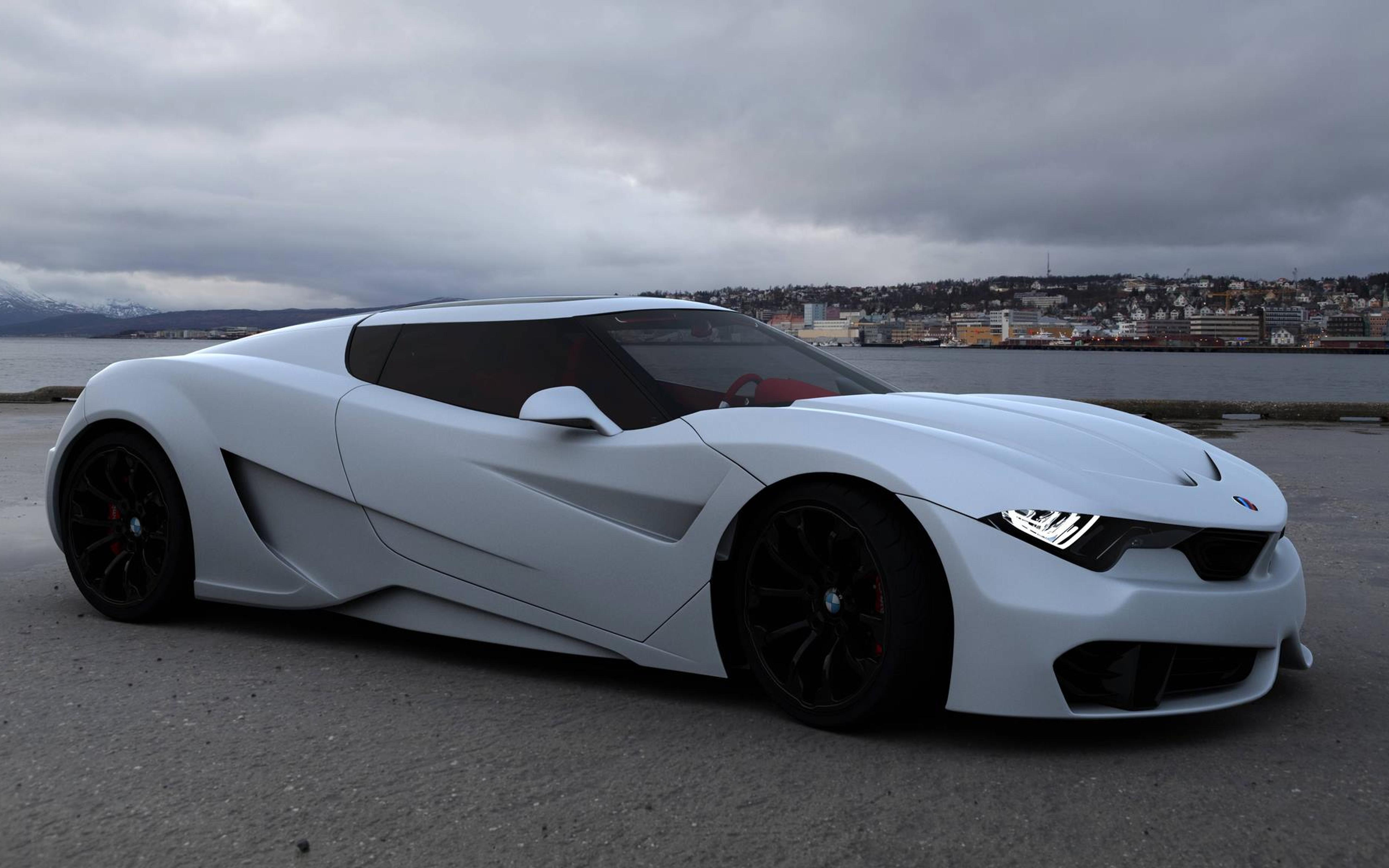 BMW M9 concept on the sea shore Wallpaper Download 5120x3200