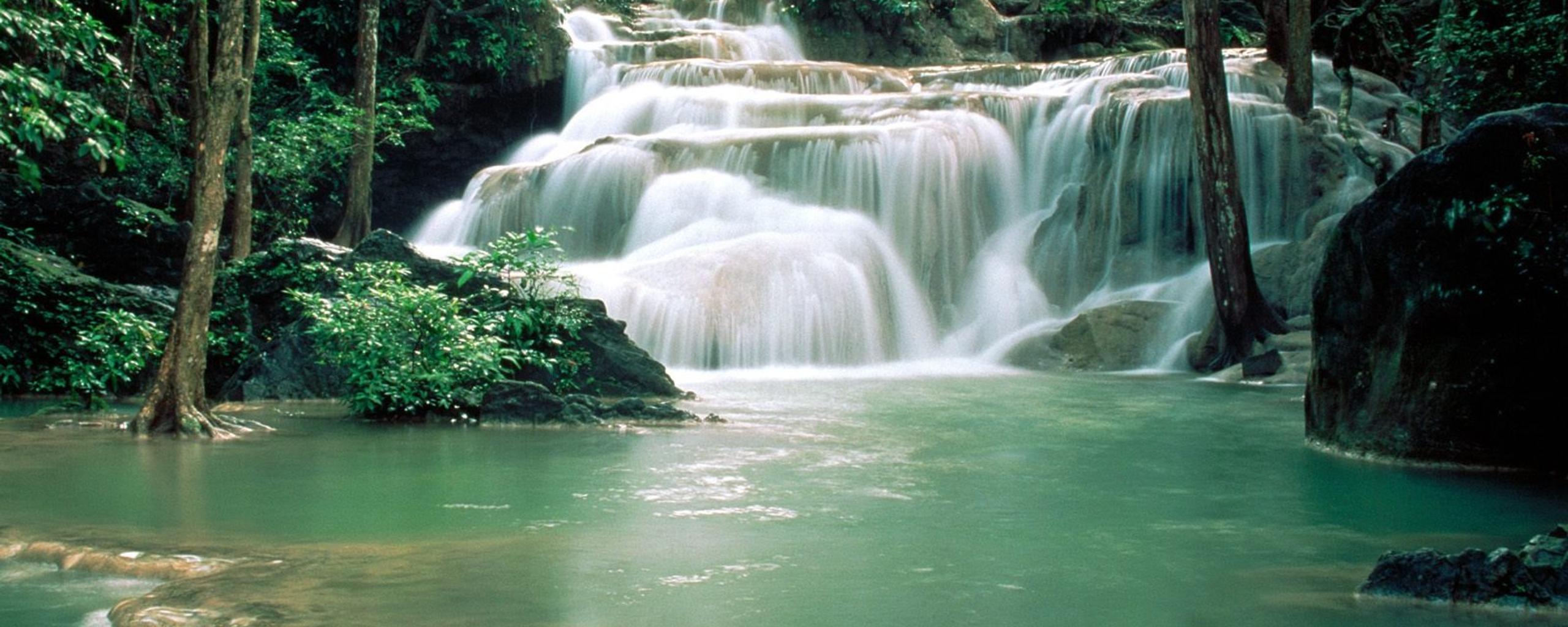 Download Wallpaper 2560x1024 Cold mountain river - HD beautiful nature wallpaper