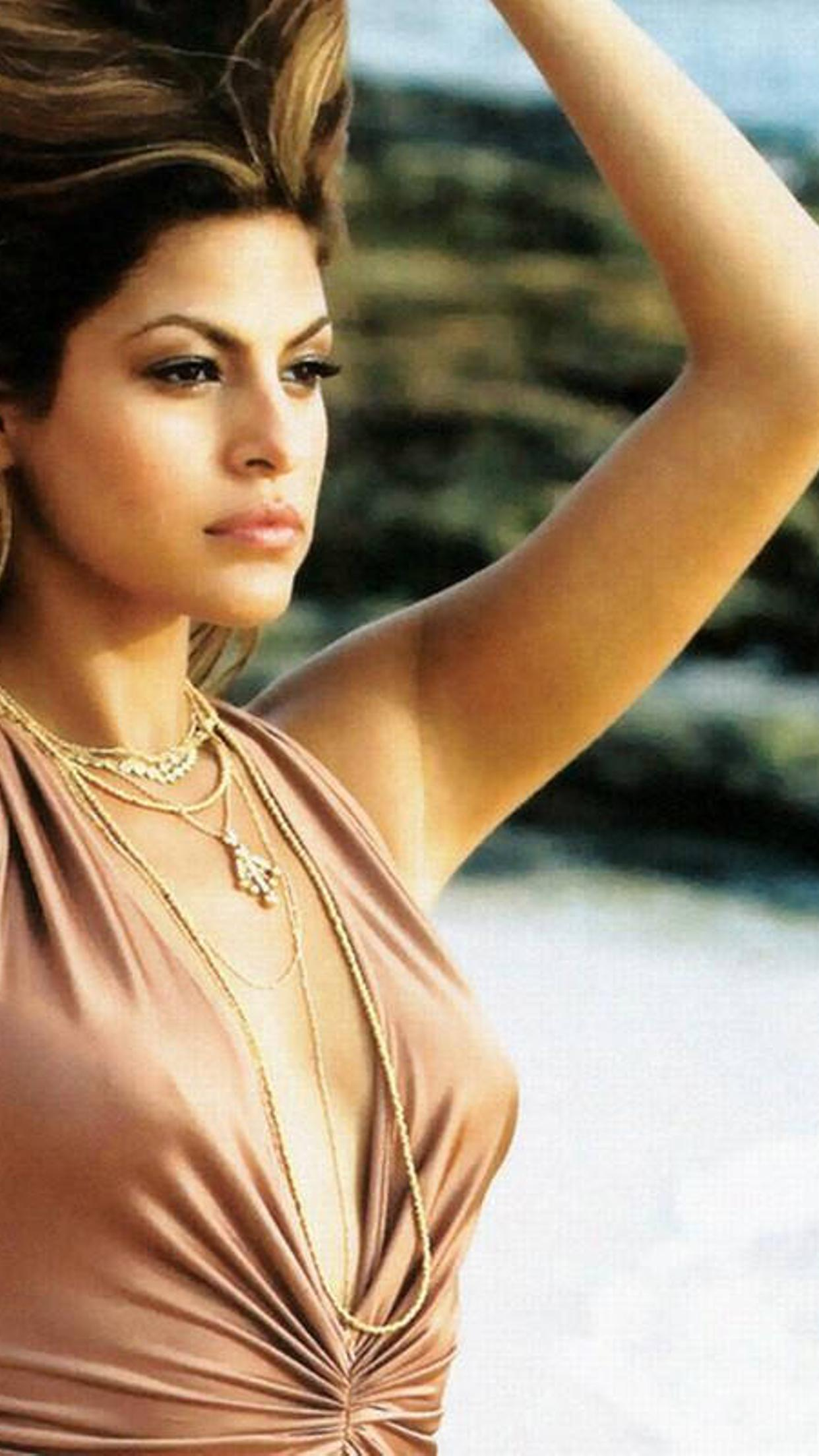 eva mendes with hair in the wind on the beach wallpaper download