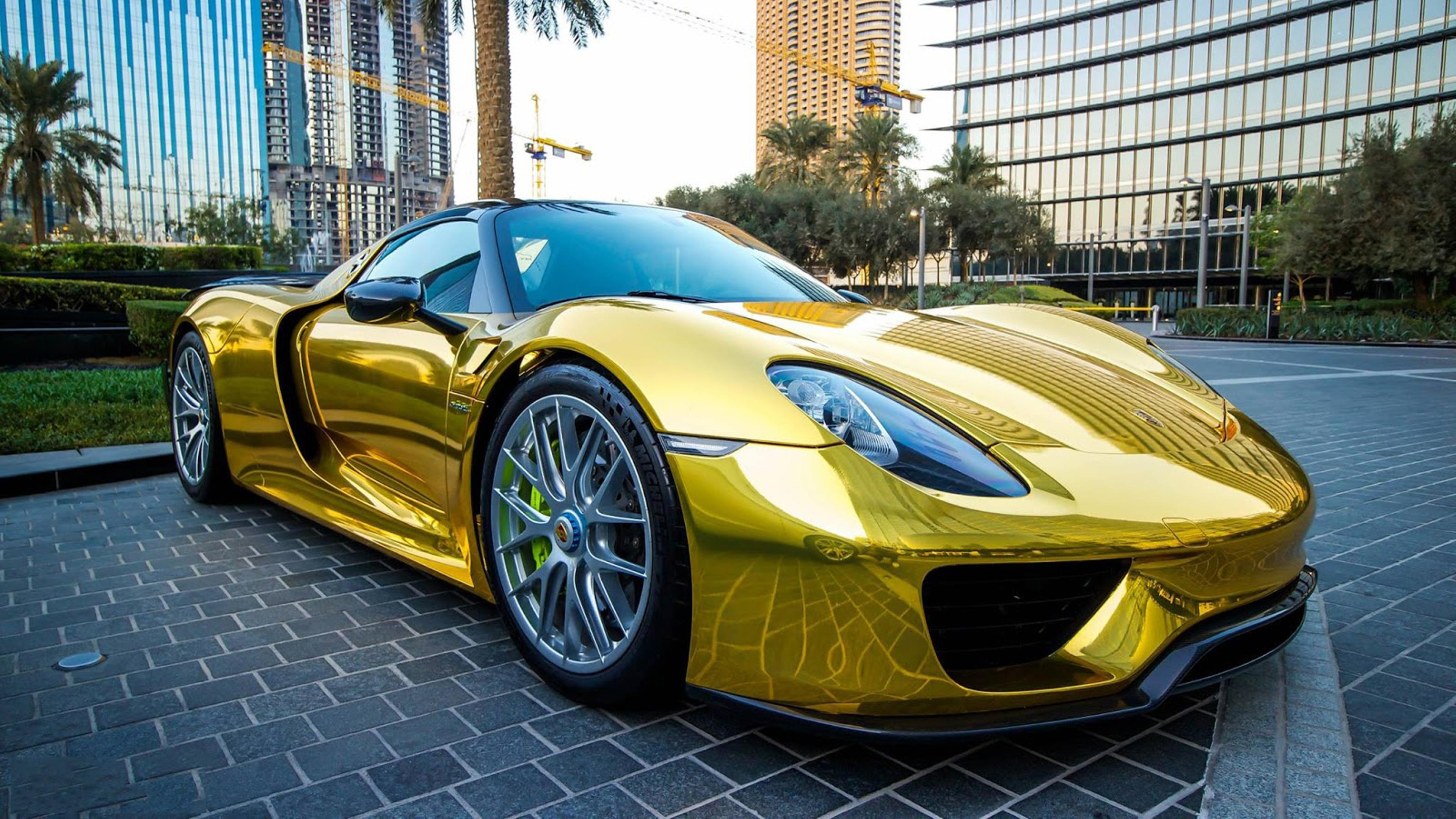 gold porsche 918 spyder in the parking wallpaper download 3840x2160