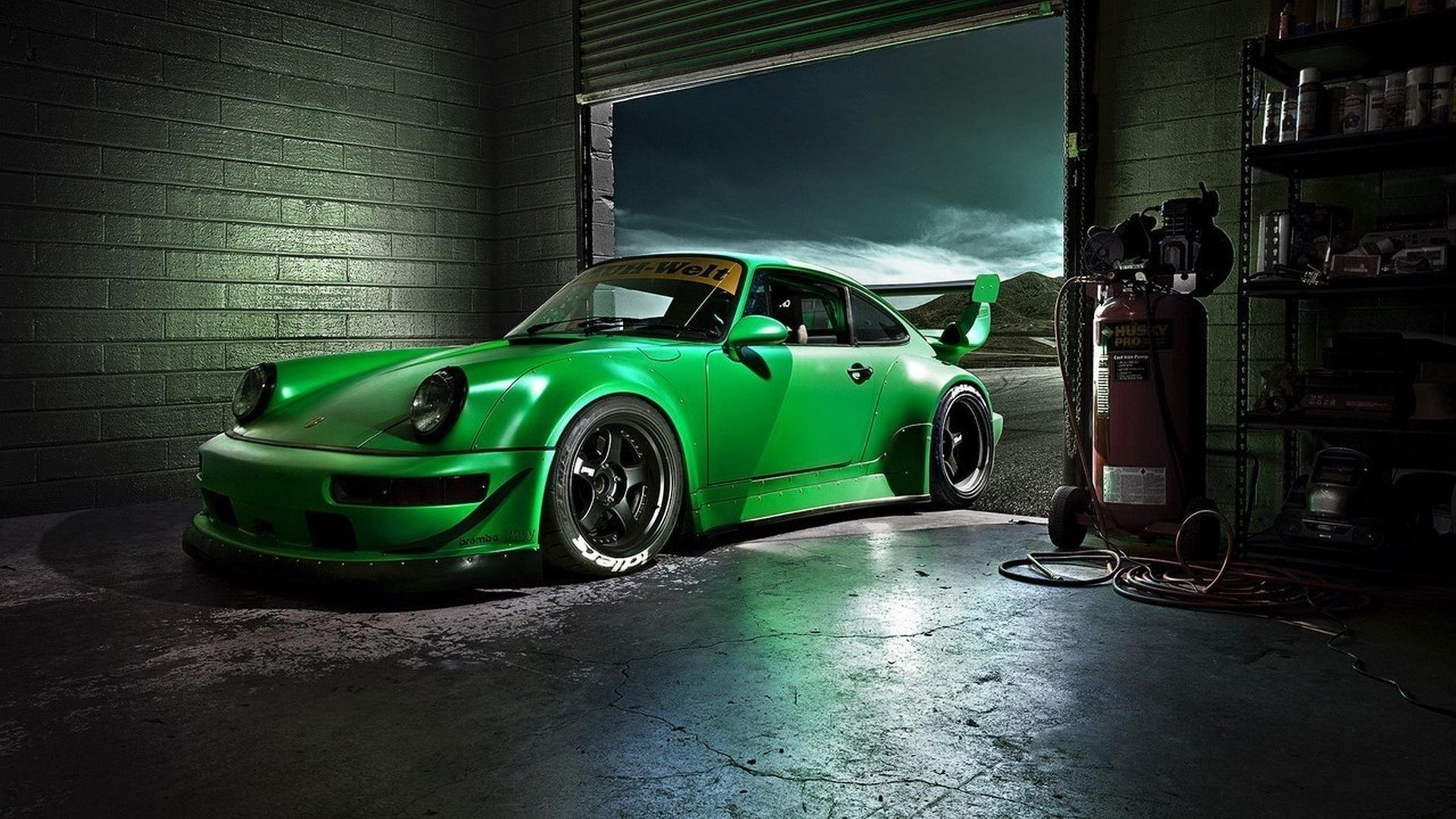 Green Porsche Carrera In A Garage Sports Car Wallpaper