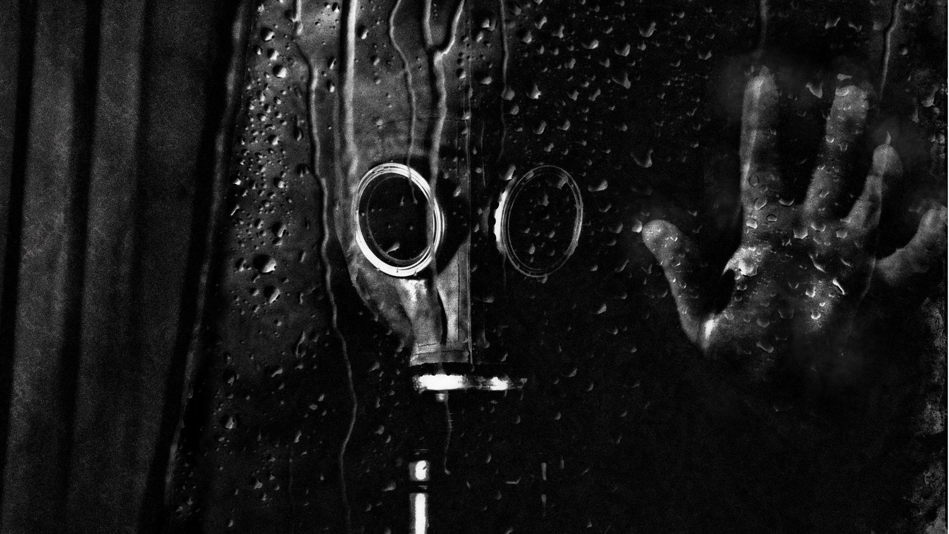 Man With Gas Mask On His Face Looking Out The Window Wallpaper Download 1920x1080