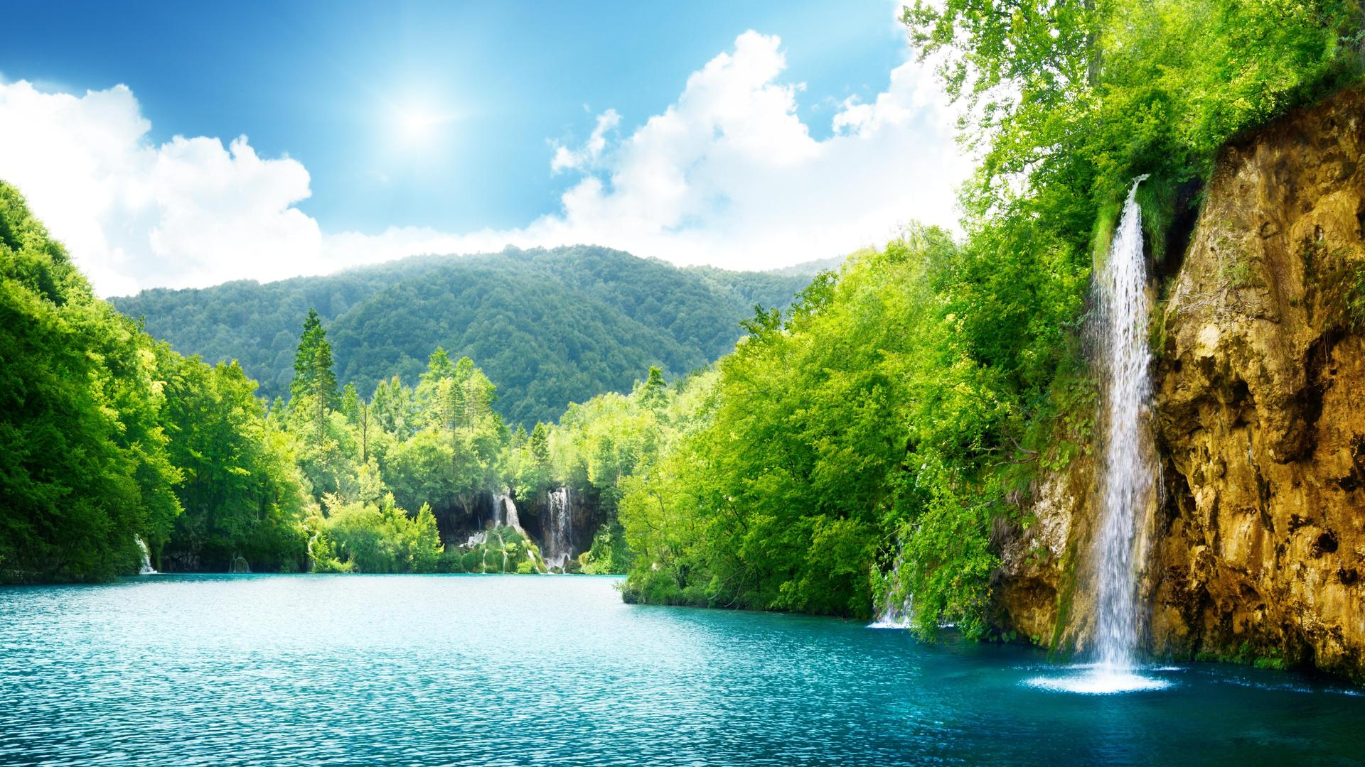 Summer Sunny Day And Wonderful Waterfall In The Nature