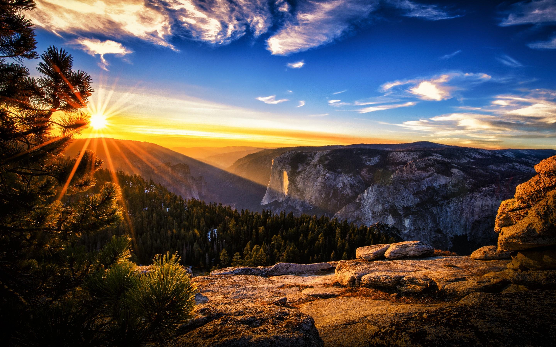 Sunlight Illuminates The Mountaintops