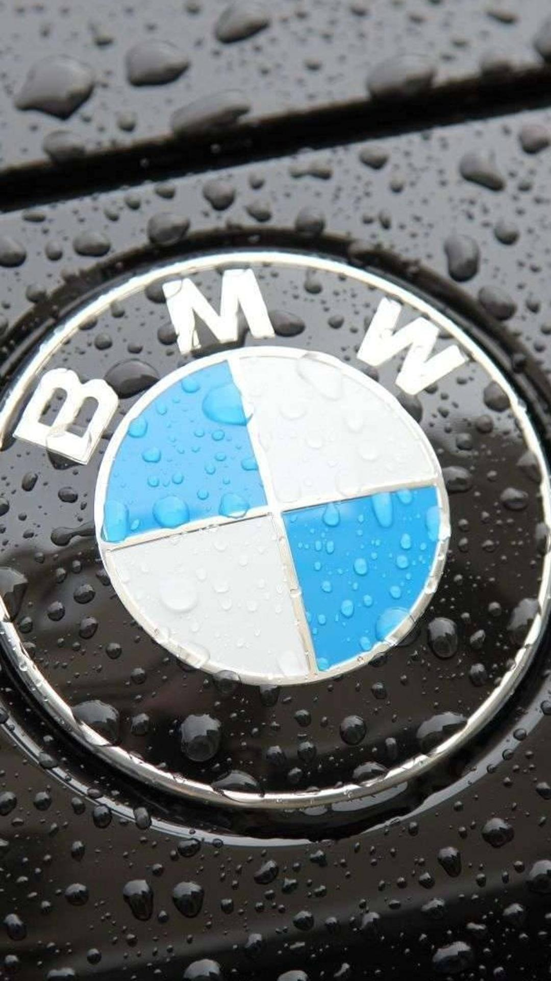 the bmw logo on a black car with raindrops wallpaper download 1080x1920