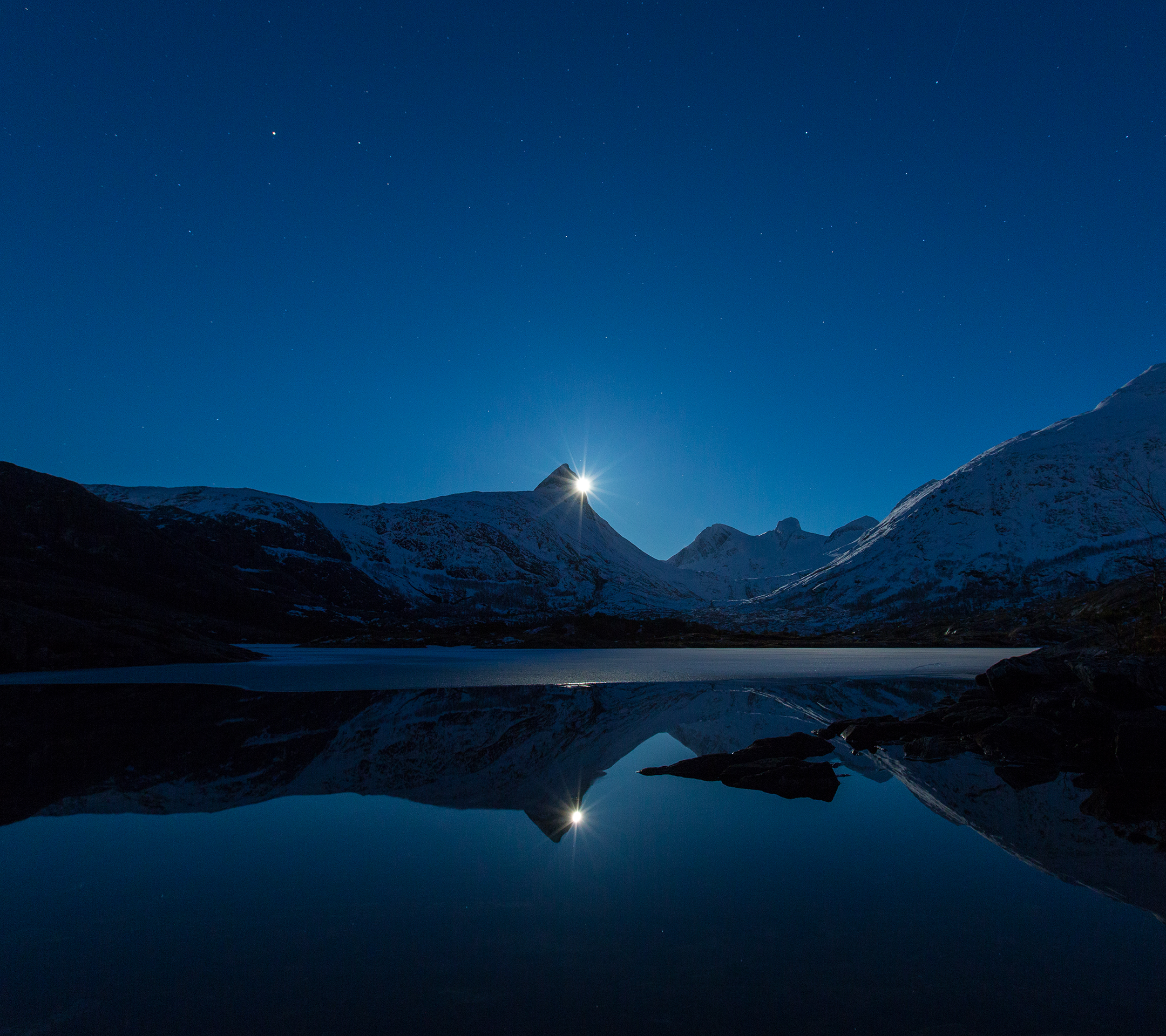 The Moon Rising Over The Mountains
