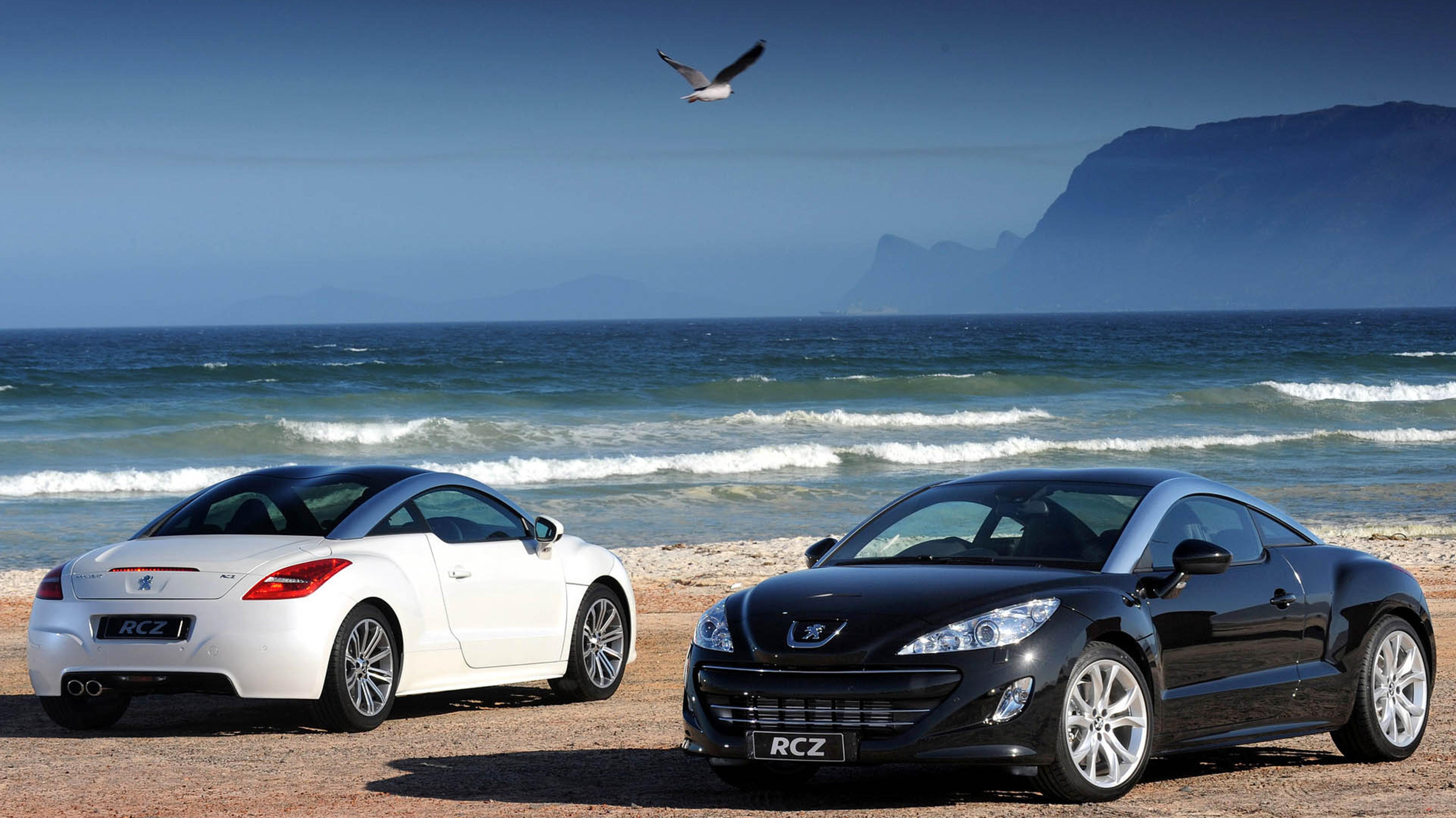 Two Peugeot Rcz On The Beach Wallpaper Download 5120x2880