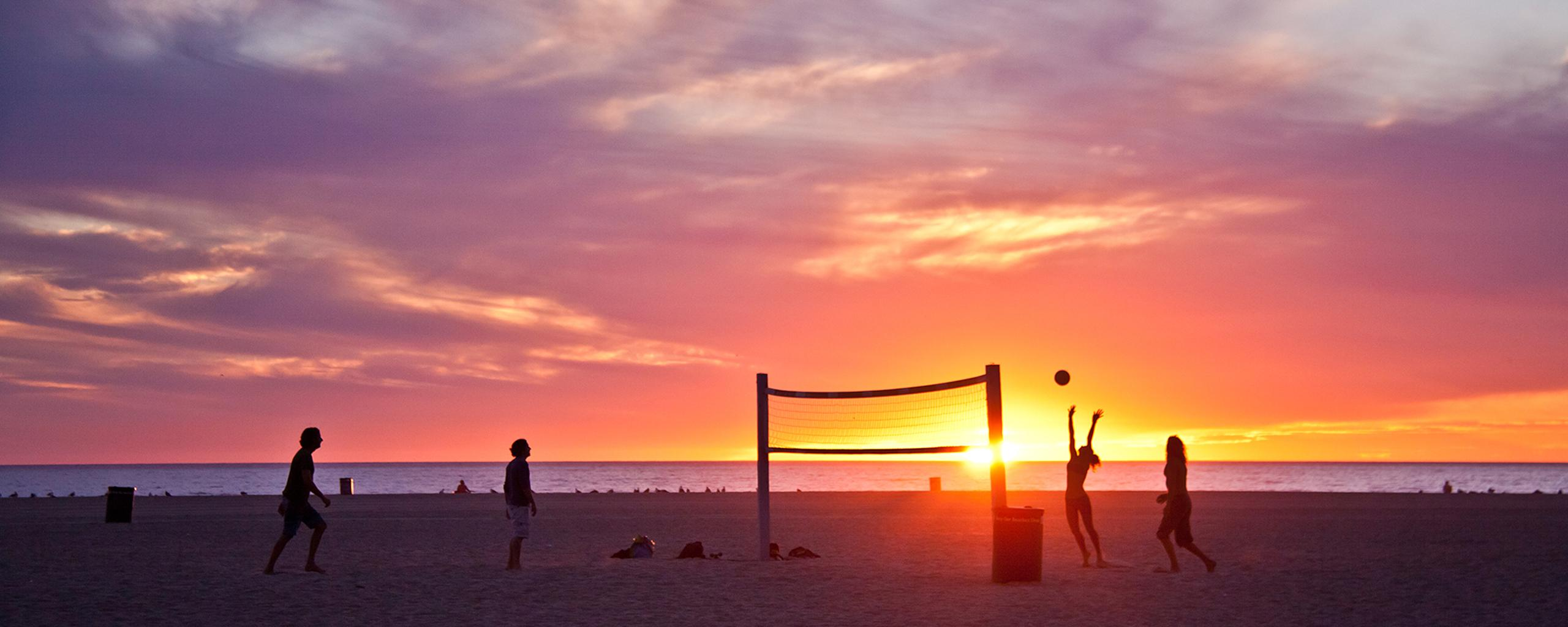 Download Wallpaper 2560x1024 Volleyball on beach, sunset