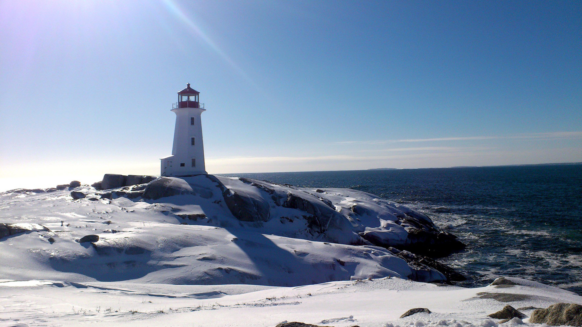 winter time on the sea lighthouse in the sun. Black Bedroom Furniture Sets. Home Design Ideas