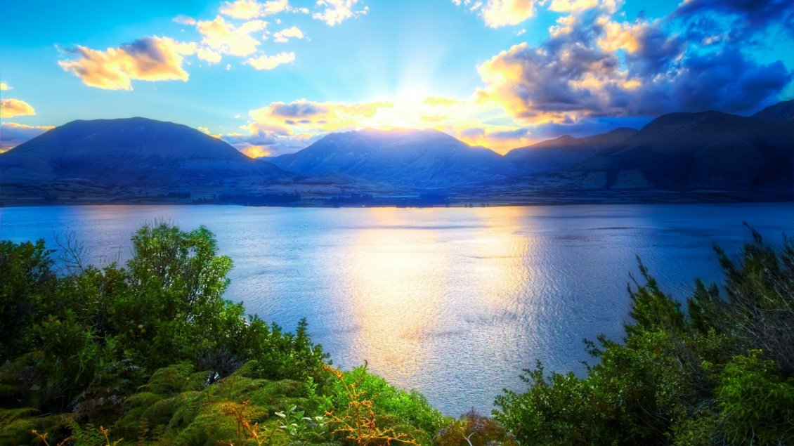 Download Wallpaper Relaxing landscape with water, mountains and sunlight