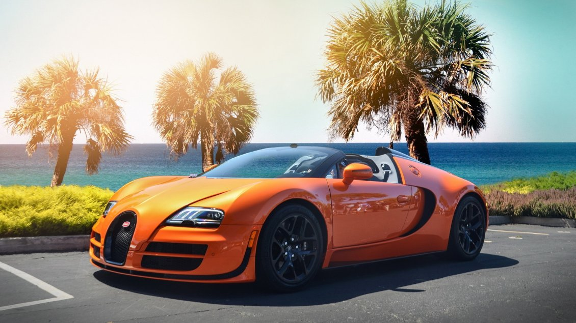 Download Wallpaper Gorgeous orange Bugatti Veyron w16 on the shore of sea