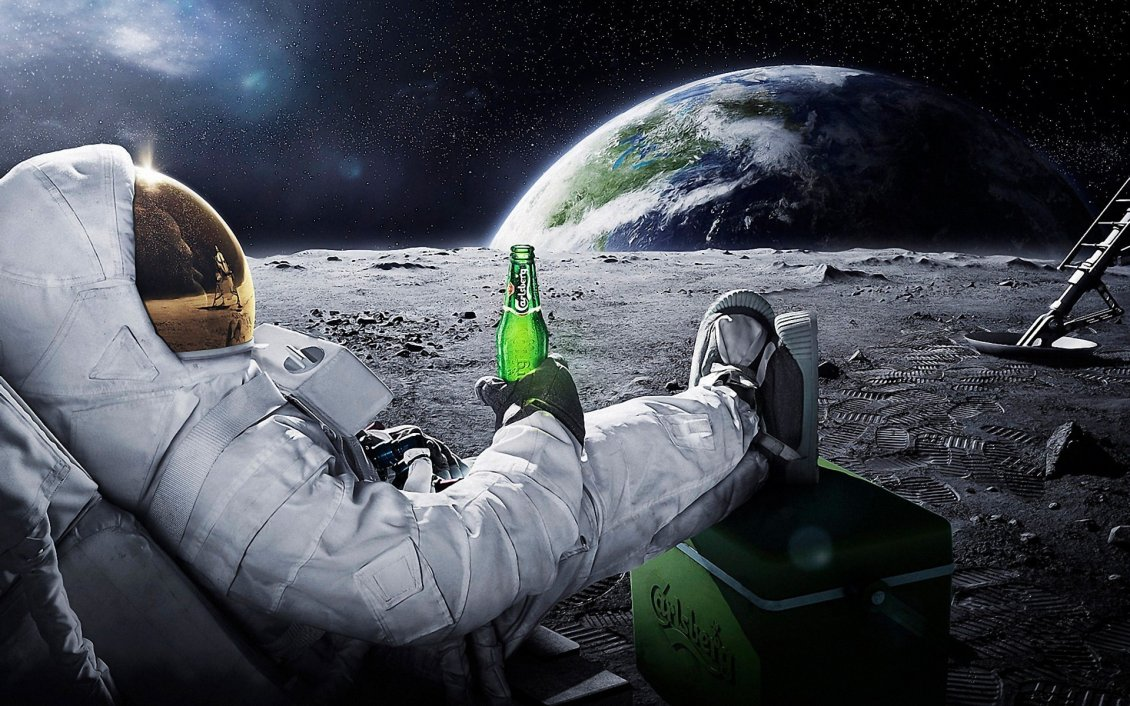 Download Wallpaper A men in space with a carlsberg beer