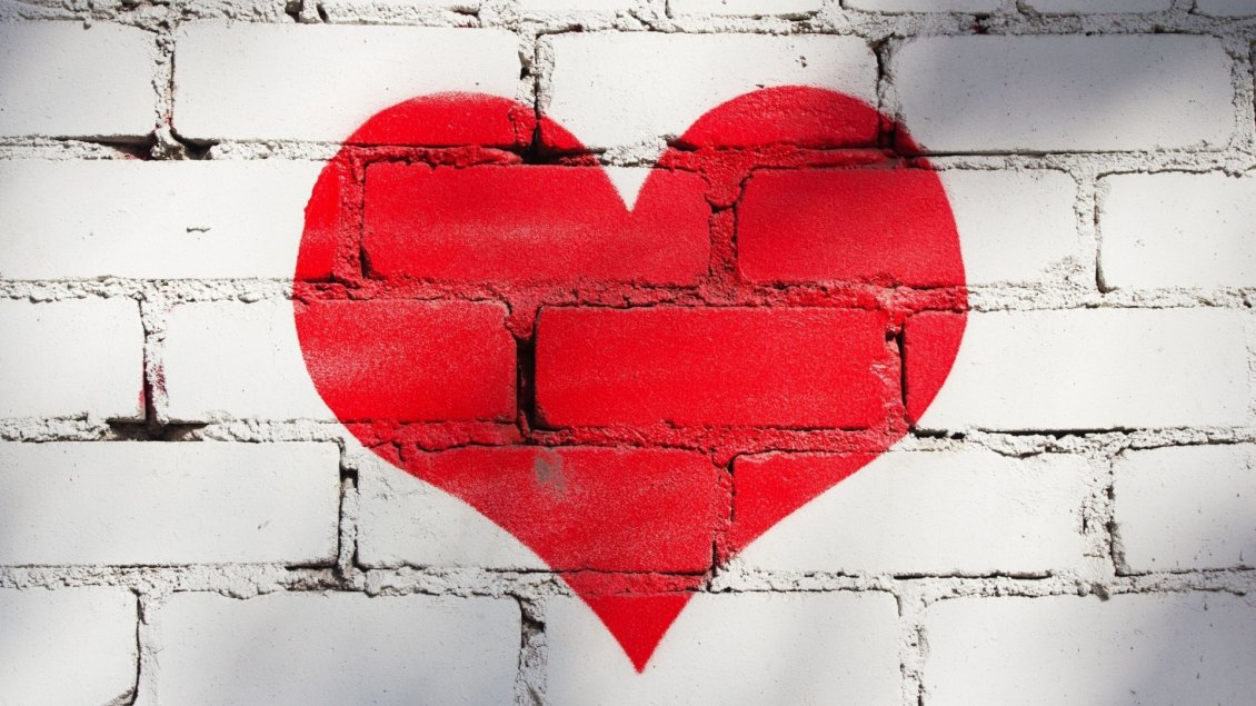 Download Wallpaper A big red heart painted on the wall made of brick