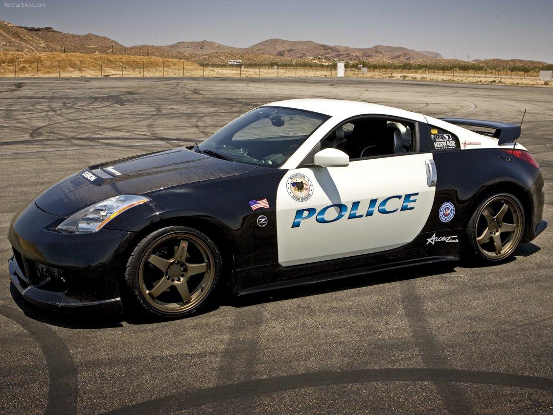 Police Sport Car On A Track Nissan 350z