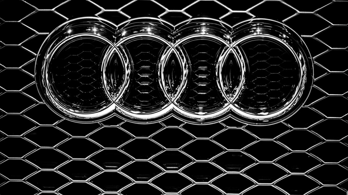 Audi Emblem On A Grille Metal Logo Wallpaper