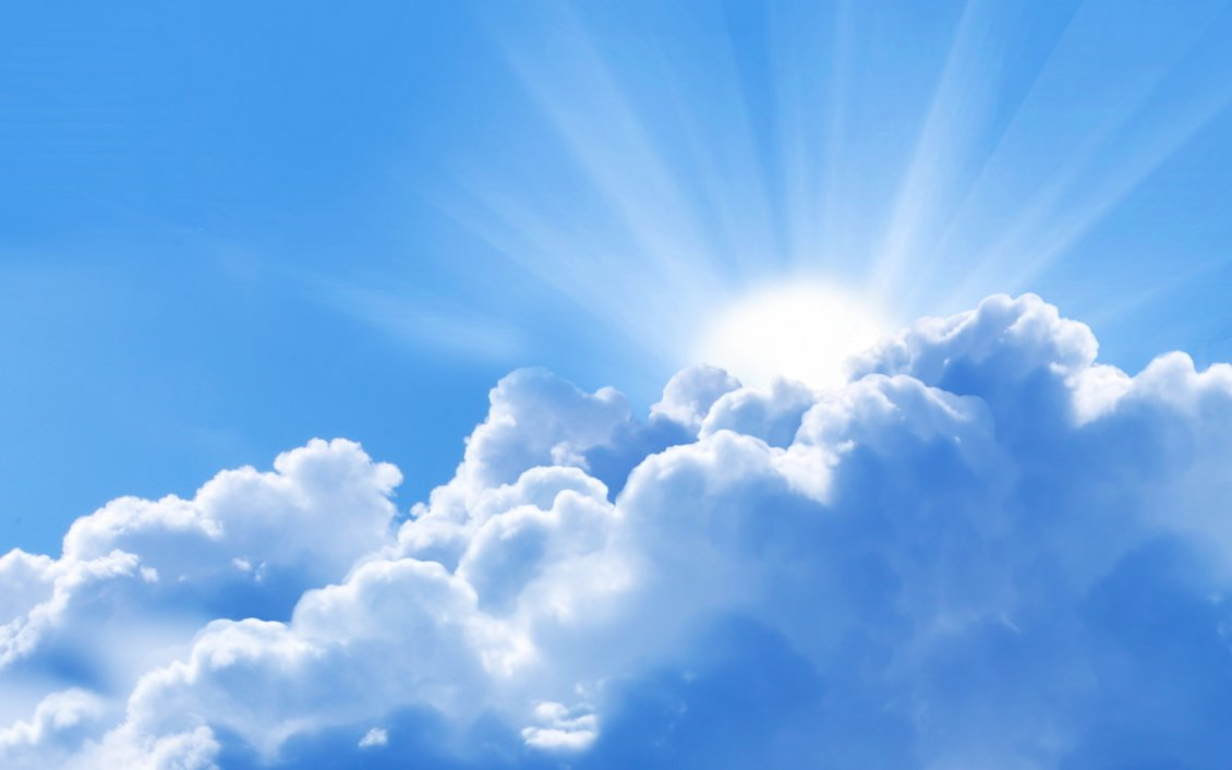 Download Wallpaper Good morning sun - beautiful sunshine over the clouds