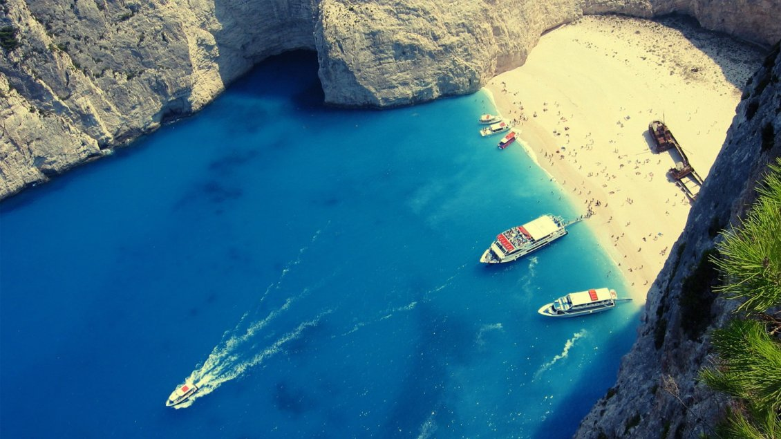 Download Wallpaper Boats at a famous beach in Greece - HD wallpaper