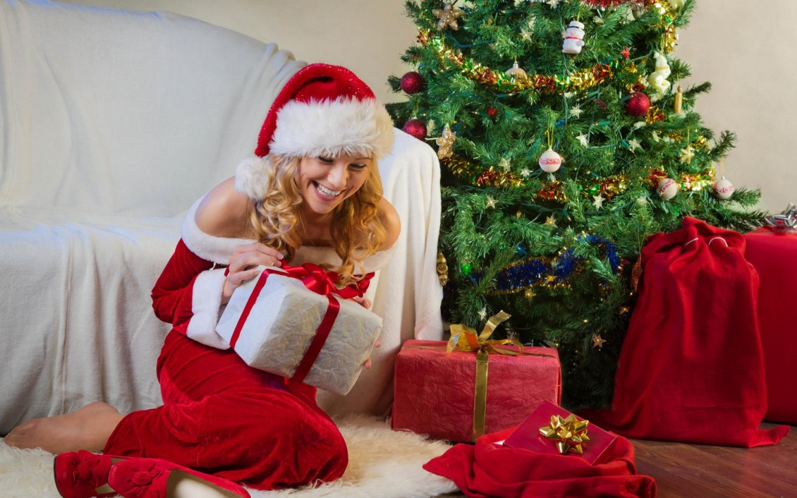 Download Wallpaper Happy girl open the Christmas gifts from Santa Claus