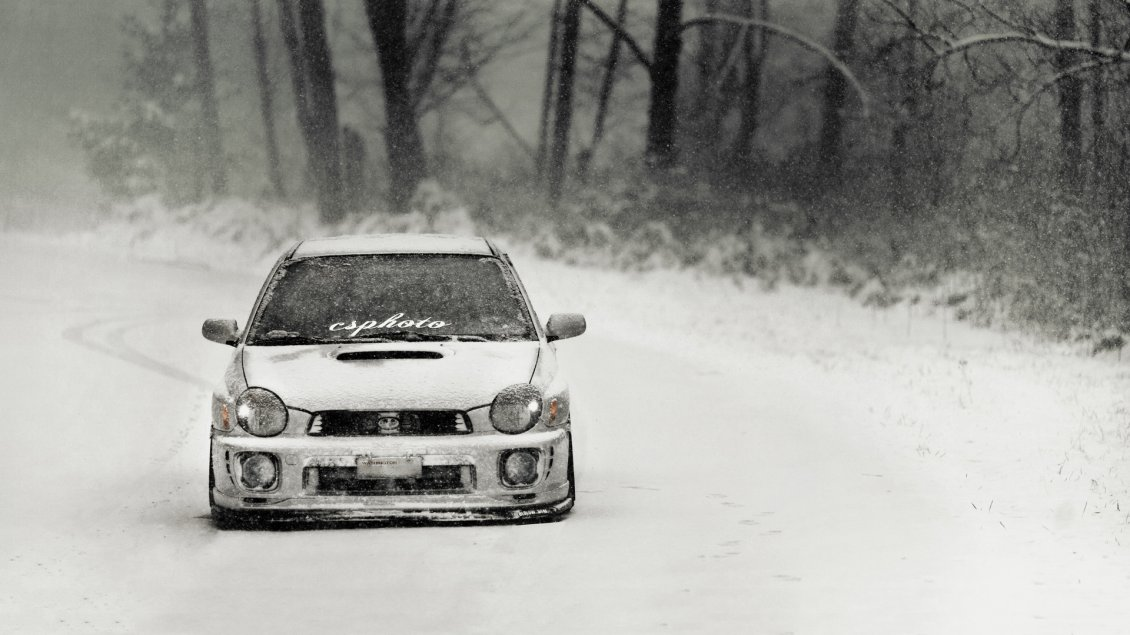 Download Wallpaper White race car on the road in the winter season