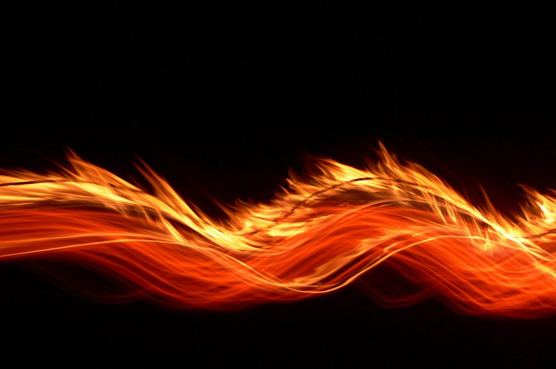 Download Wallpaper Orange fire on a dark background - HD wallpaper