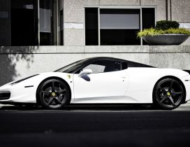 White Ferrari Spider with black rims