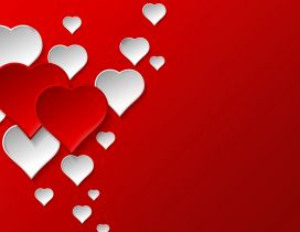 Two red hearts between many white hearts