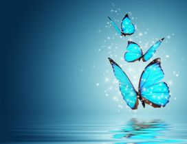 Three blue and magic butterflies