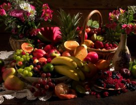 Table with many fruits and flowers