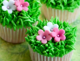 Muffins with grass and flowers arrangement