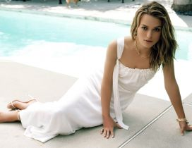 Keira Knightley in a white dress near the pool