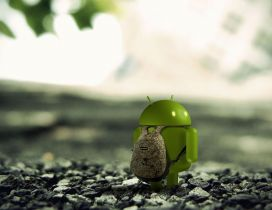 An android with a backpack on the stones