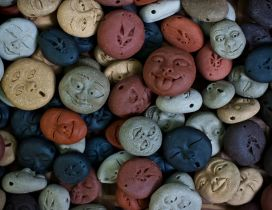 Many smiley faces in different colors