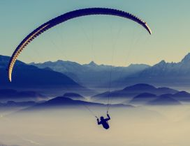 A man with paraglider over the mountains