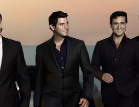 Members of Il divo band in black suits