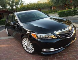 Black Acura RLX in front of house