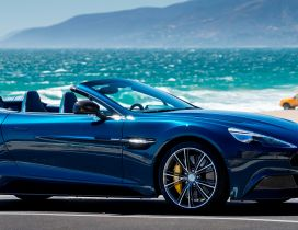 Blue and convertible Aston Martin Vanquish Volante