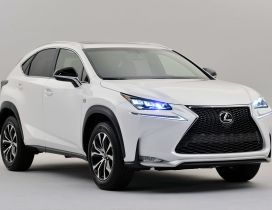 White Lexus NX 300h with lit headlights